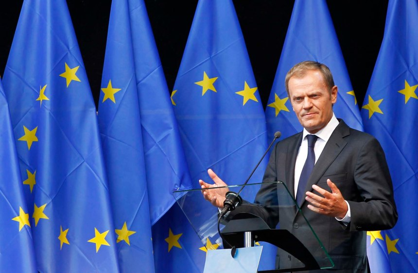 Poland's PM Tusk delivers a speech during a ceremony at the EU Parliament in Brussels