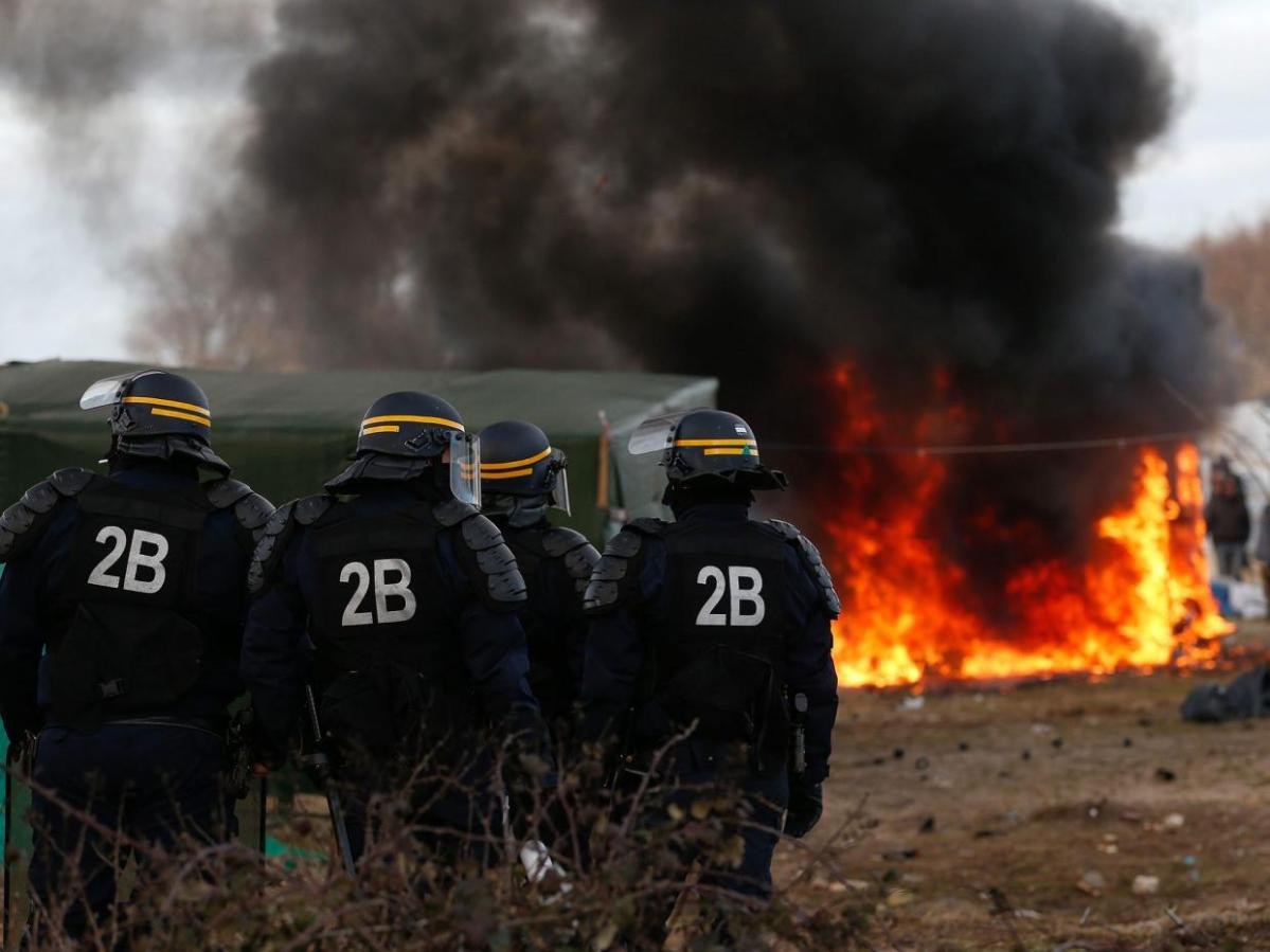 Calais Jungle brawls stopped by riot police