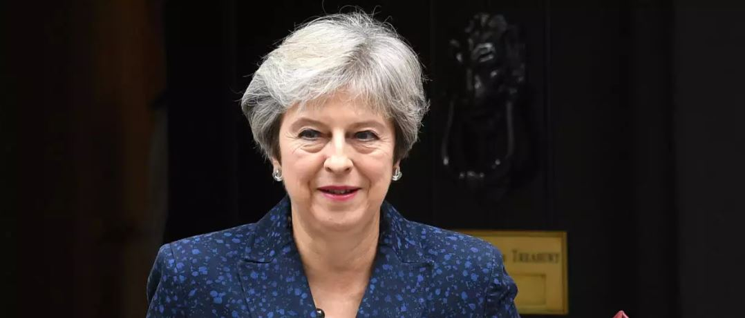 May warns critics about 'no deal' exit